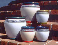 A selection of outdoor pots with a hand painted design