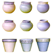 A selection of glazed ceramic pots with a hand painted design