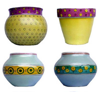 A selection of hand painted designs on different indoor and outdoor glazed pot shapes