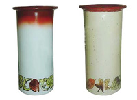 A selection of ceramic wine coolers with a hand painted grape & leaf design