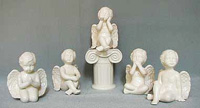 A selection of solid glaze ceramic religious figurines in various colours